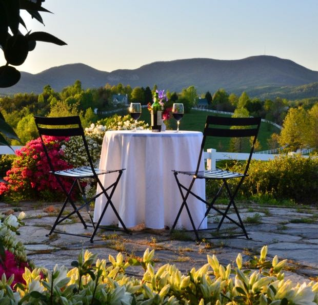 Wine on a table with mountain views. Romantic and relaxing.